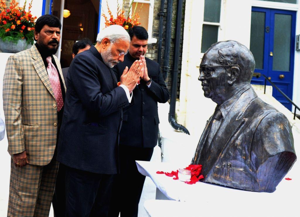 :London: Prime Minister Narendra Modi  and Maharashtra Devendra Fadnavis at Dr. Bhimrao Ramji Ambedkar Memorial, in London on Nov 14, 2015. Also seen RPI president Ramdas Athawale. (Photo: ... - Narendra Modi