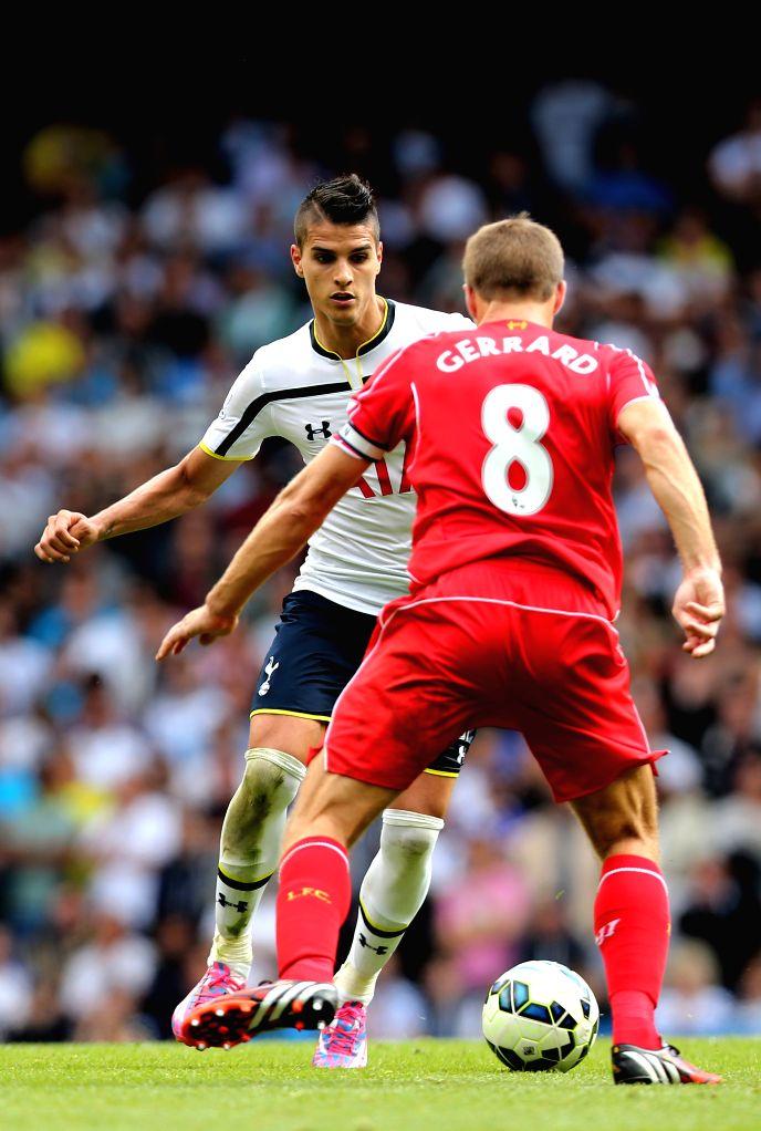 Erik Lamela (L) of Tottenham Hotspur breaks through during the Barclays Premier League match between Liverpool and Tottenham Hotspur at White Hart Lane in London, ...