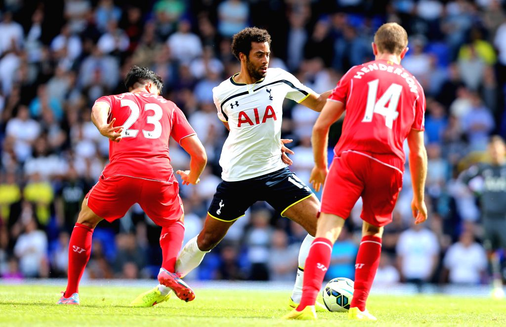 Mousa Dembele (C) of Tottenham Hotspur breaks through during the Barclays Premier League match between Liverpool and Tottenham Hotspur at White Hart Lane in London, .