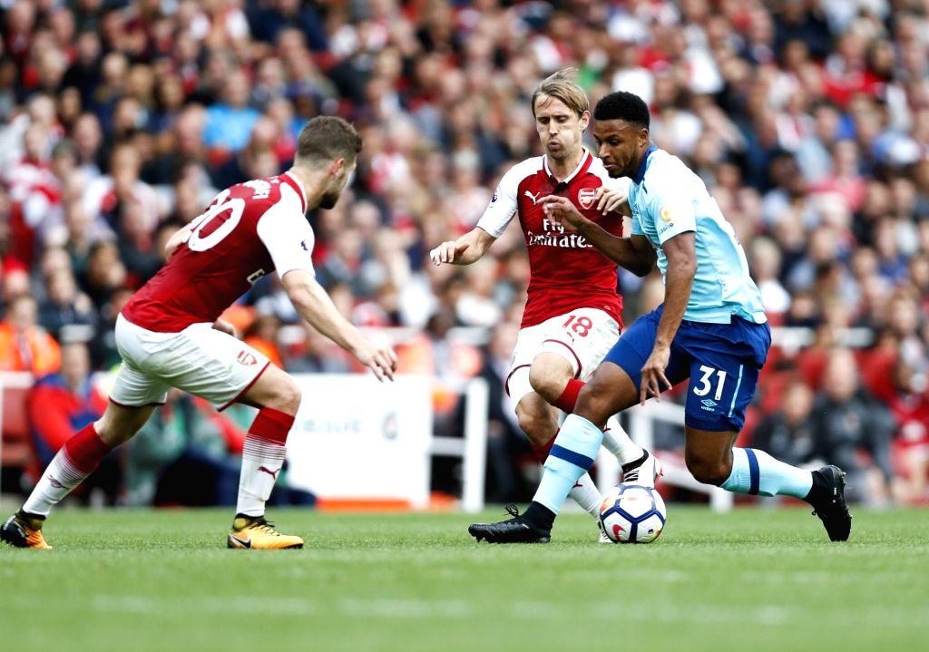LONDON, Sept. 10, 2017 - Lys Mousset (R) of Bournemouth breaks through during the English Premier League match between Arsenal and Bournemouth at the Emirates Stadium in London, Britain on Sept. 9, ...