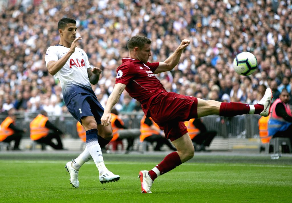 LONDON, Sept. 15, 2018 - Liverpool's James Milner (R) controls the ball during the English Premier League match between Tottenham Hotspur and Liverpool at the Wembley Stadium in London, Britain on ...