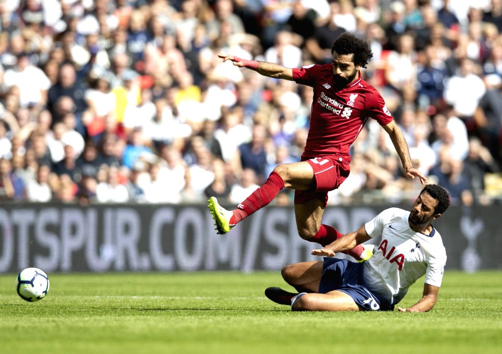 LONDON, Sept. 15, 2018 - Liverpool's Mohamed Salah (L) vies with Tottenham Hotspur's Mousa Dembele during the English Premier League match between Tottenham Hotspur and Liverpool at the Wembley ...