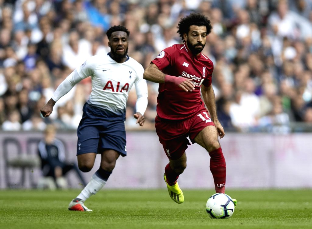 LONDON, Sept. 15, 2018 - Liverpool's Mohamed Salah (R) breaks through during the English Premier League match between Tottenham Hotspur and Liverpool at the Wembley Stadium in London, Britain on ...