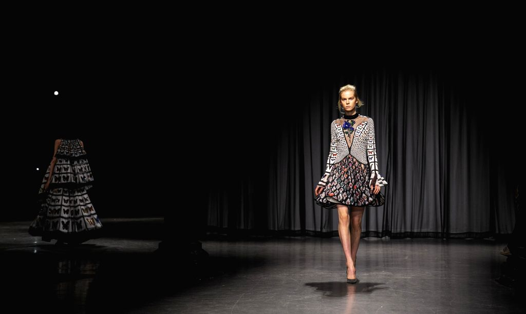 LONDON, Sept. 16, 2018 - A model walks the runway at the Mary Katrantzou Show during the London Fashion Week in London, Britain, on Sept. 15, 2018.