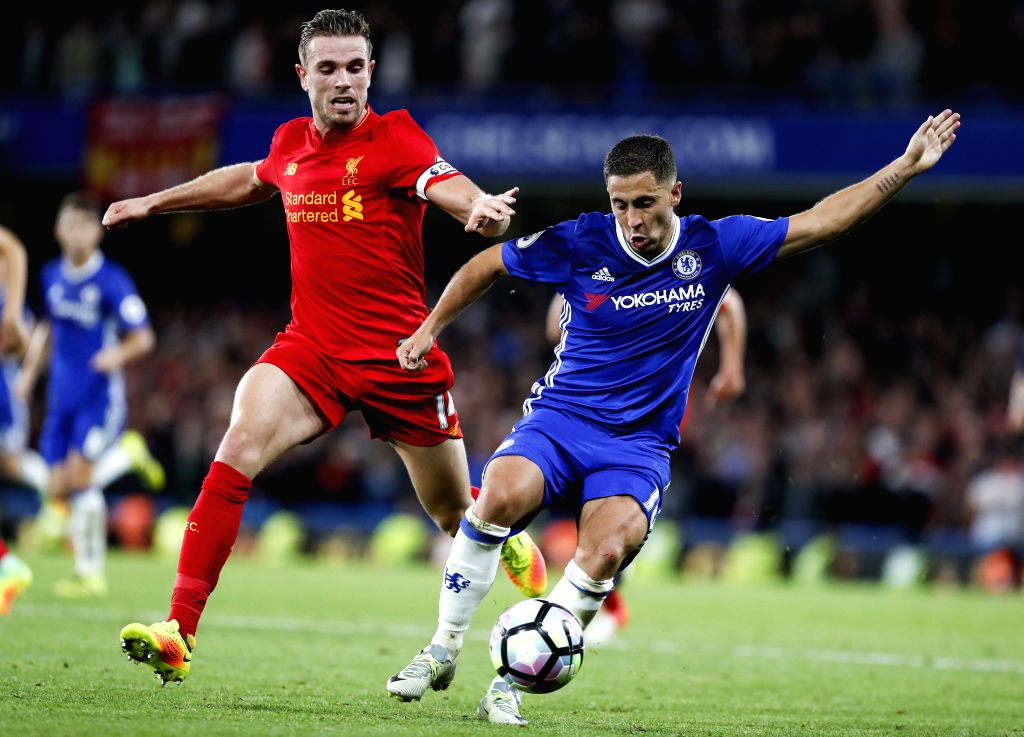 LONDON, Sept. 17,  2016 - Eden Hazard (R) of Chelsea vies for the ball with Jordan Henderson of Liverpool during their English Premier League match in London, Britain, on Sept. 16, 2016. Liverpool ...
