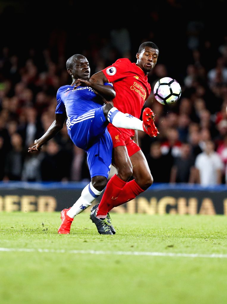 LONDON, Sept. 17,  2016 - Ngolo Kant (L) of Chelsea vies for the ball during the English Premier League match between Chelsea and Liverpool in London, Britain, on Sept. 16, 2016. Liverpool won 2-1.