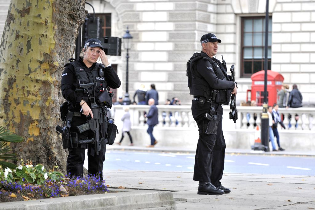 LONDON, Sept. 17, 2017 - Police patrol on a street in London, Britain on Sept. 17, 2017. British Home Secretary Amber Rudd said on Sunday that the United Kingdom's terrorism threat level has been ...
