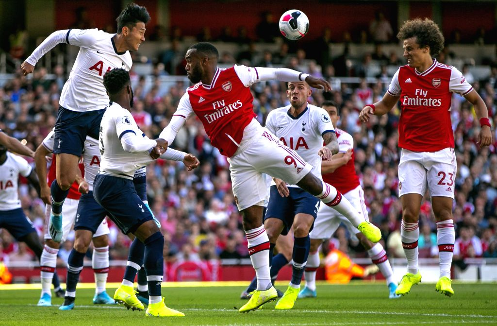 LONDON, Sept. 2, 2019 (Xinhua) -- Tottenham Hotspur's Heung-Min Son (L, top) vies with Arsenal's Alexandre Lacazette (C, top) during the English Premier League north London Derby match between Arsenal and Tottenham Hotspur at Emirates Stadium in Lond