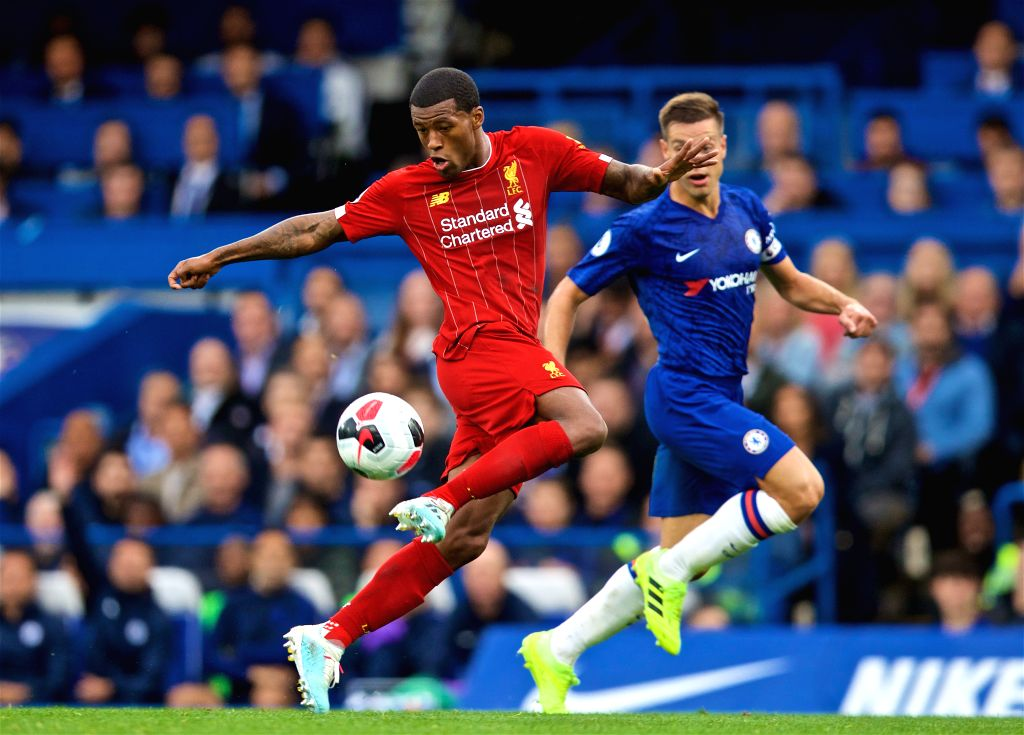 LONDON, Sept. 23, 2019 - Liverpool's Georginio Wijnaldum (L) controls the ball during the English Premier League match between Chelsea and Liverpool at Stamford Bridge in London, Britain on Sept. 22, ...