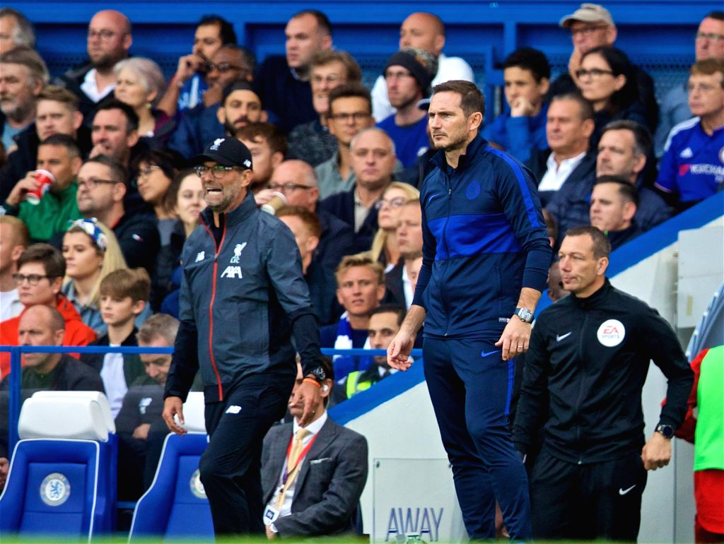 LONDON, Sept. 23, 2019 - Liverpool's head coach Jurgen Klopp (L) and Chelsea's coach Frank Lampard react during the English Premier League match between Chelsea and Liverpool at Stamford Bridge in ...