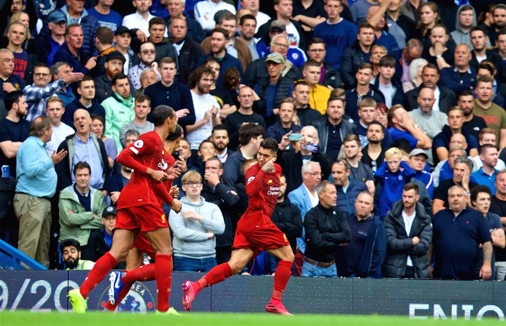 LONDON, Sept. 23, 2019 - Liverpool's Roberto Firmino (R) celebrates during the English Premier League match between Chelsea and Liverpool at Stamford Bridge in London, Britain on Sept. 22, 2019.