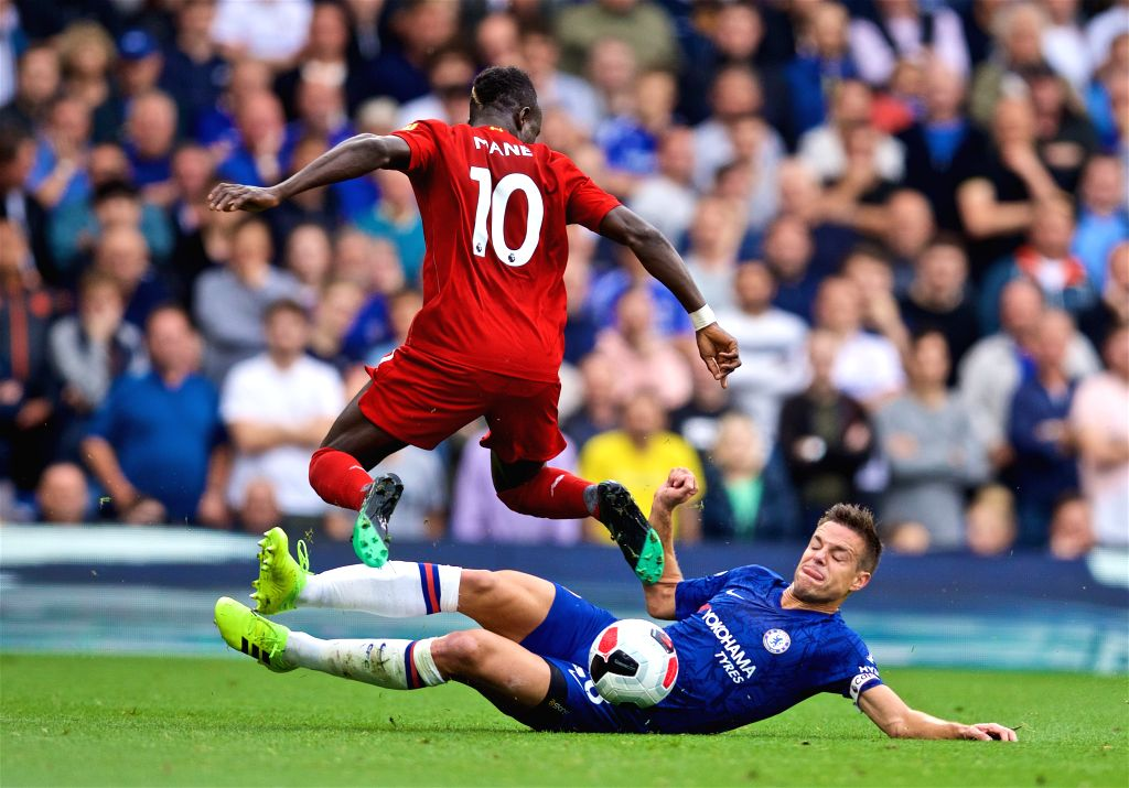 LONDON, Sept. 23, 2019 - Liverpool's Sadio Mane (L) is tackled by Chelsea's Cesar Azpilicueta during the English Premier League match between Chelsea and Liverpool at Stamford Bridge in London, ...