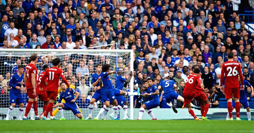 LONDON, Sept. 23, 2019 - Liverpool's Trent Alexander-Arnold (3rd R) scores a goal during the English Premier League match between Chelsea and Liverpool at Stamford Bridge in London, Britain on Sept. ...