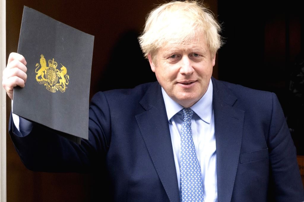 LONDON, Sept. 25, 2019 (Xinhua) -- British Prime Minister Boris Johnson leaves 10 Downing Street to attend the reopening of the Parliament in London, Britain, on Sept. 25, 2019. British Prime Minister Boris Johnson faced enormous pressure as the parl - Boris Johnson