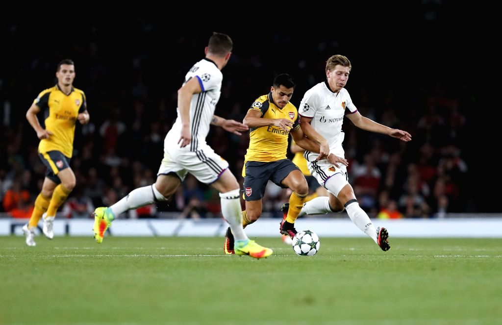 LONDON, Sept. 29, 2016 - Alexis Sanchez (2nd R) of Arsenal breaks through during the UEFA Champions League Group A match between Arsenal and Basel at the Emirates Stadium in London, Britain on Sept. ...