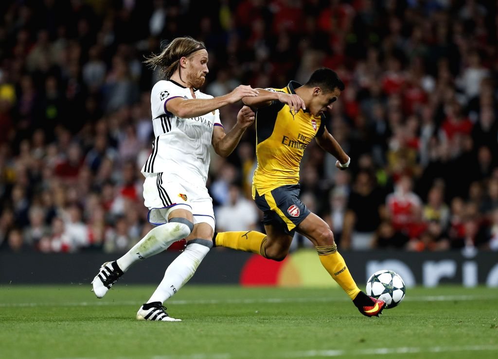 LONDON, Sept. 29, 2016 - Alexis Sanchez (R) of Arsenal vies with Michael Lang of Basel during the UEFA Champions League Group A match between Arsenal and Basel at the Emirates Stadium in London, ...