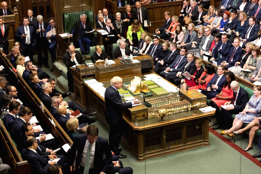 LONDON, Sept. 3, 2019 - British Prime Minister Boris Johnson (C) speaks in the House of Commons in London, Britain, on Sept. 3, 2019. British Prime Minister Boris Johnson on Tuesday lost a key Brexit ... - Boris Johnson