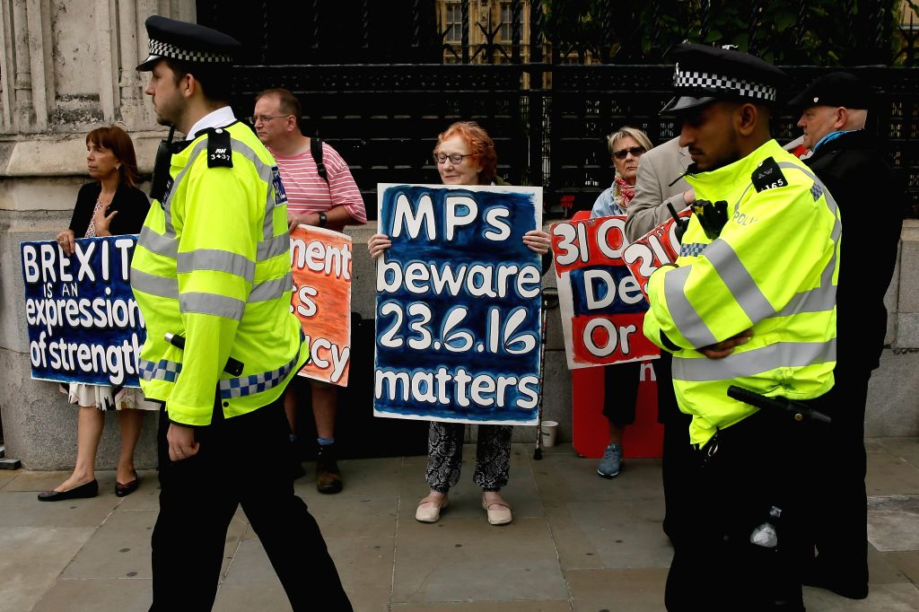 LONDON, Sept. 3, 2019 - Demonstrators gather outside the Houses of Parliament in London, Britain, Sept. 3, 2019. Rebel Tory members of the British parliament are poised to join their colleagues from ... - Boris Johnson