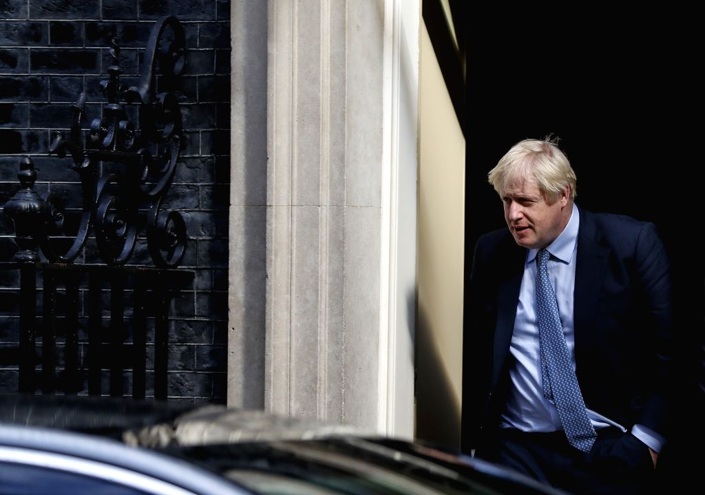 LONDON, Sept. 4, 2019 - British Prime Minister Boris Johnson leaves 10 Downing Street for the Prime Minister's Questions at the House of Commons in London, Britain, on Sept. 4, 2019. - Boris Johnson