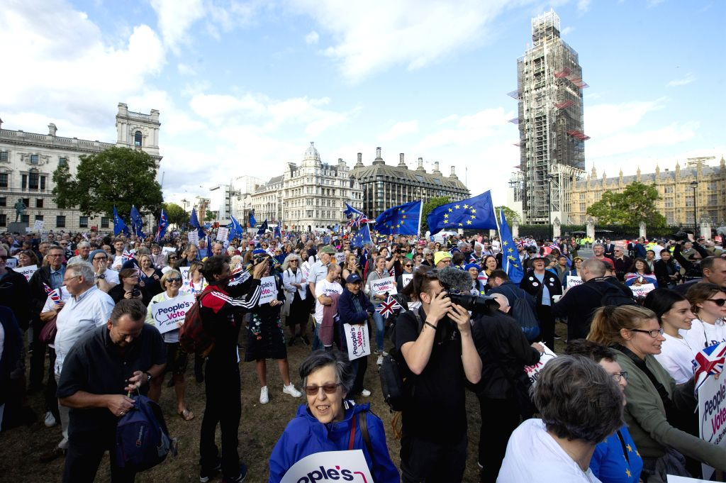 LONDON, Sept. 4, 2019 - Demonstrators gather outside the Houses of Parliament in London, Britain, on Sept. 4, 2019. British lawmakers on Wednesday rejected a motion tabled by Prime Minister Boris ... - Boris Johnson