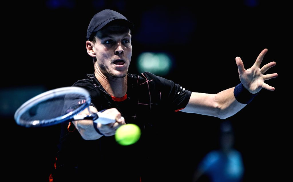 Tomas Berdych of the Czech Republic returns the ball during the ATP World Tour Finals Group match against Marin Cilic of Croatia in London, Britain, on Nov. 12, 2014. Berdych won 2-0. ...