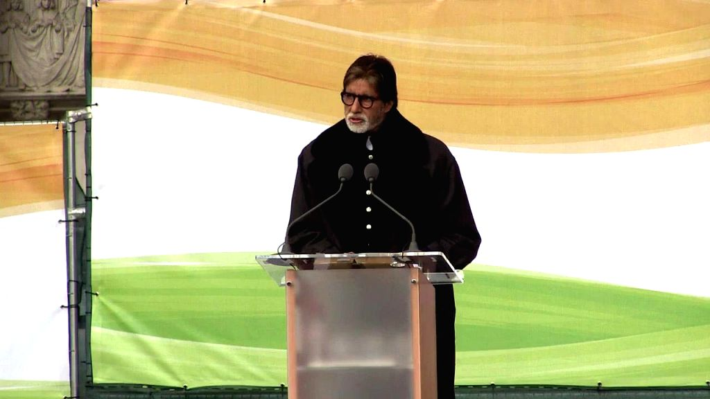 London (UK): Actor Amitabh Bachchan addresses during a programme organised to unveil a nine feet high bronze statue of Mahatma Gandhi at the Parliament Square in London, UK on March 14, 2015. - Amitabh Bachchan