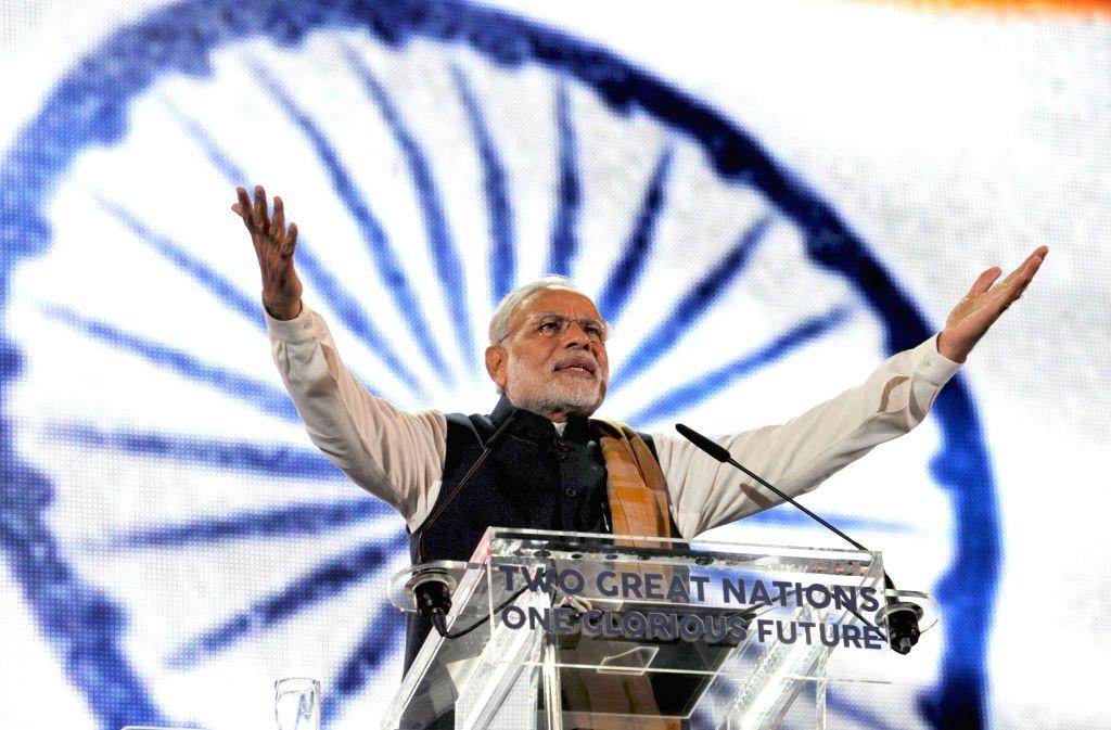 London (UK): Prime Minister Narendra Modi addresses at Wembley Stadium, in London on Nov 13, 2015. - Narendra Modi