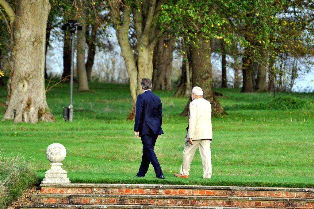 London (UK): Prime Minister Narendra Modi and Prime Minister of United Kingdom (UK), David Cameroon during a private tete-a-tete, at Chequers, in London on Nov 13, 2015. - Narendra Modi