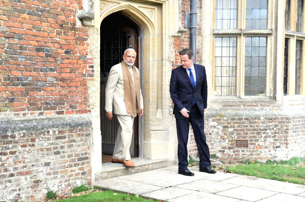 :London (UK): Prime Minister Narendra Modi and Prime Minister of United Kingdom (UK), David Cameroon during a private tete-a-tete, at Chequers, in London on Nov 13, 2015. (Photo: IANS/PIB). - Narendra Modi