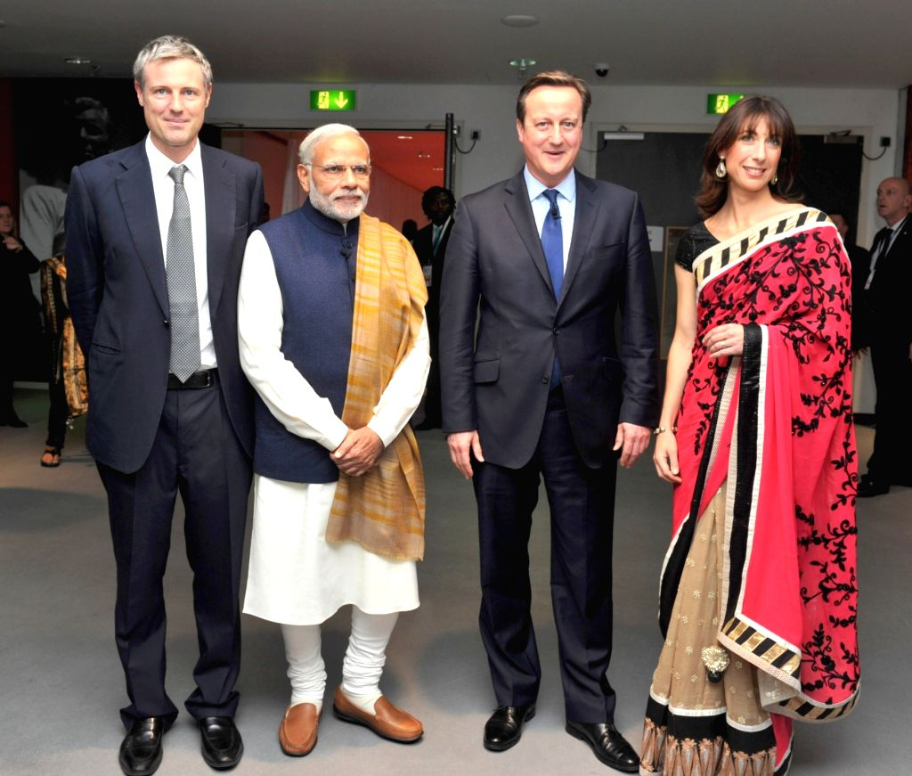 :London (UK): Prime Minister Narendra Modi being received by the Prime Minister of United Kingdom (UK), David Cameroon and Mrs. Cameron at Wembley Stadium, in London on Nov 13, 2015. (Photo: ... - Narendra Modi