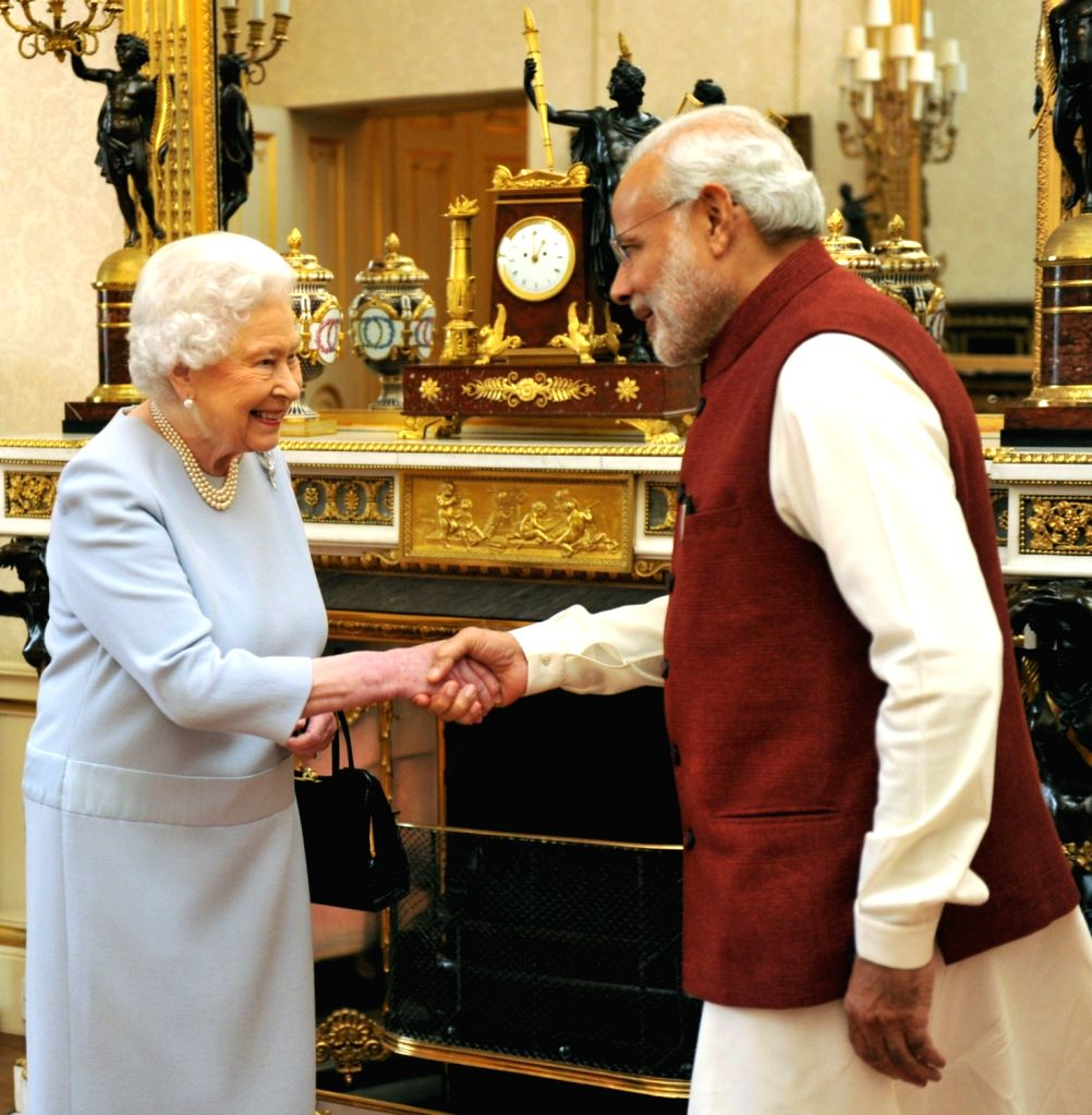 London (UK): Prime Minister Narendra Modi meets Her Majesty the Queen Elizabeth II, of the United Kingdom, at Buckingham Palace, in London on Nov 13, 2015. - Narendra Modi
