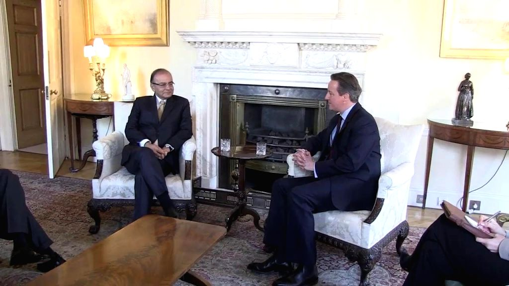 London (UK): Union Minister for Finance, Corporate Affairs, and Information and Broadcasting Arun Jaitley and British Prime Minister David Cameron during a meeting in London, UK on March 14, 2015. - David Cameron and Arun Jaitley