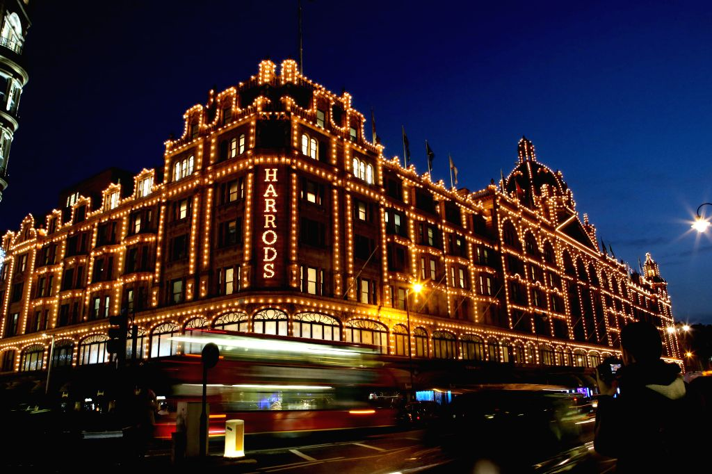Vehicles pass London's famous luxury department store Harrods, which is illuminated with Christmas lights, in London, Britain, on Nov. 19, 2014.