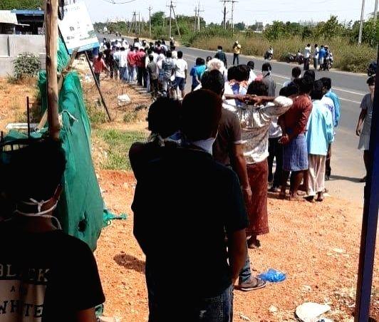 Long queues as Telangana re-opens liquor shops.