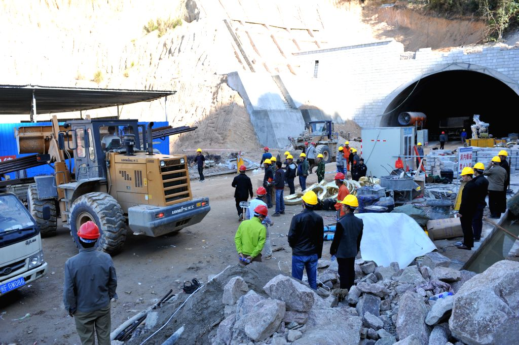 Photo taken on Dec. 5, 2014 shows the entrance of a collapsed expressway tunnel under construction in Longyan City, southeast China's Fujian Province. An rescue channel was opened at 3:30 ...
