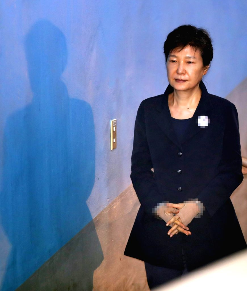 Looking stone-faced, former President Park Geun-hye enters a Seoul court on July 4, 2017, to stand trial over alleged bribery and other charges. The Constitutional Court upheld her impeachment ...