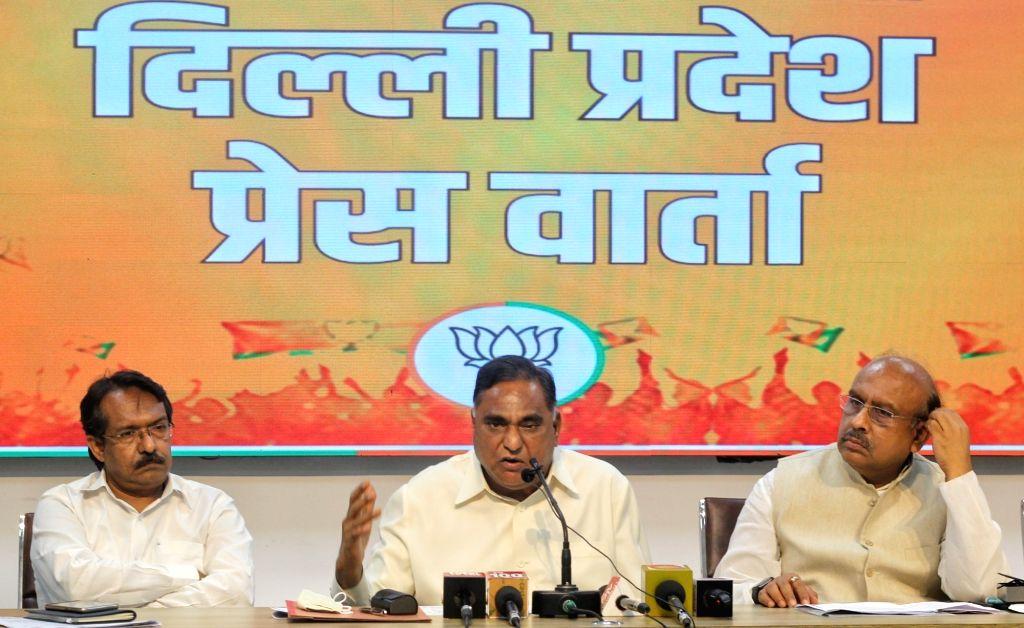 LOP Ramvir Singh Bidhuri, Former Delhi BJP President Vijendra Gupta and State General Secretary Harsh Malhotra address a press conference on an important issue at BJP state office in New ... - Ramvir Singh Bidhuri and Vijendra Gupta