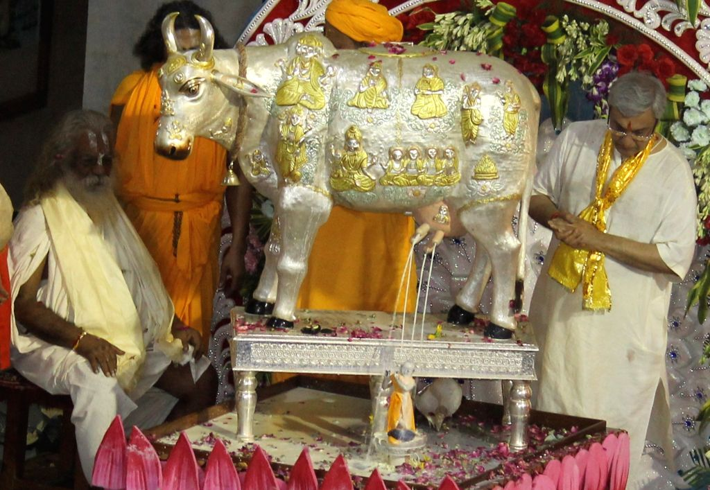 Lord Krishna's idol bathed in milk from an ornate cow figurine made from 51 kilograms of silver overlaid with gold at Shri Krishna Janmabhoomi temple in Mathura on Aug 16, 2017.