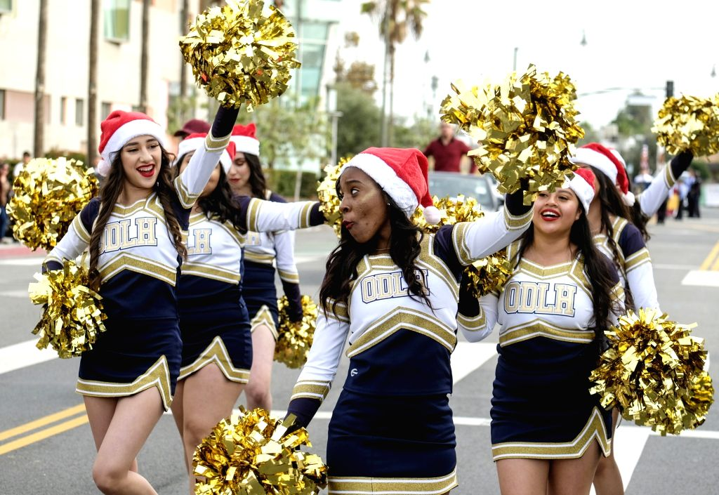 LOS ANGELES, Dec. 10, 2018 - Members of a marching band perform along the parade route during the annual Boyle Heights Christmas Parade in Los Angeles, the United States, on Dec. 9, 2018.