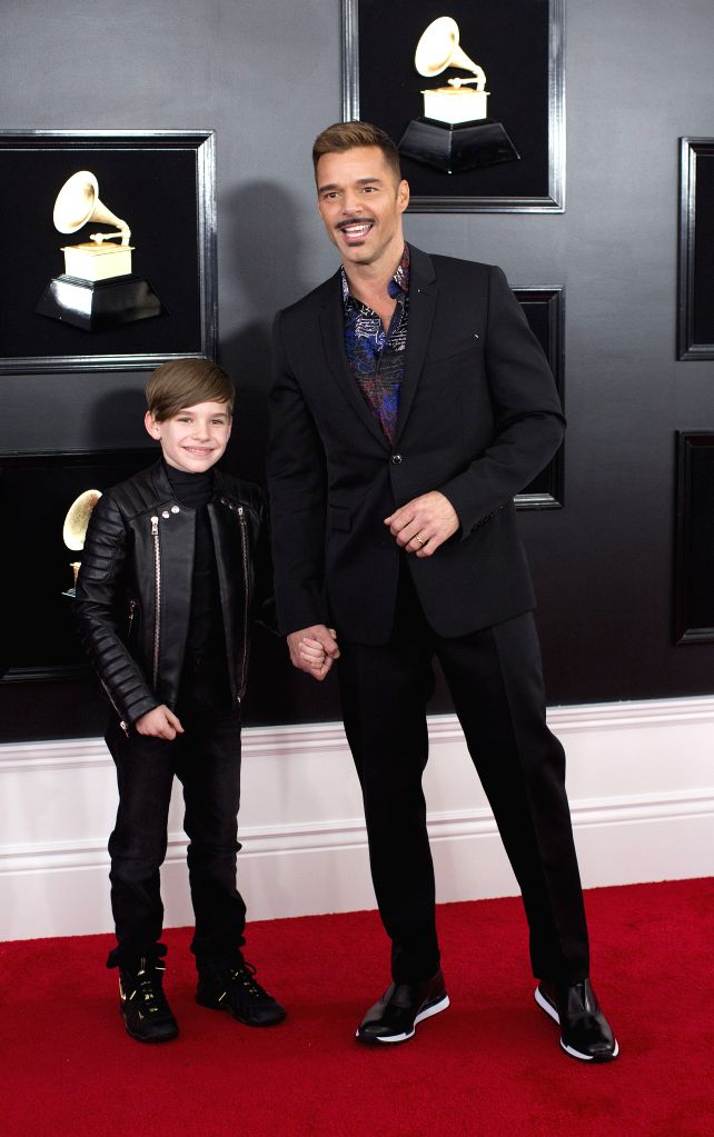 LOS ANGELES, Feb. 12, 2019 - Ricky Martin (R) and his son arrive for the 61st Annual Grammy Awards held in Los Angeles, the United States, Feb. 10, 2019.