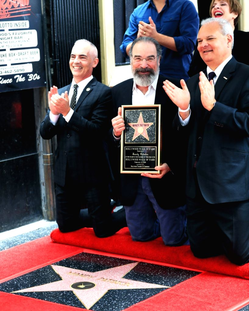 LOS ANGELES, Feb. 13, 2018 - Actor Mandy Patinkin (C) attends a star honoring ceremony on the Hollywood Walk of Fame in Los Angeles, the United States, Feb. 12, 2017. Mandy Patinkin was honored with ... - Mandy Patinkin