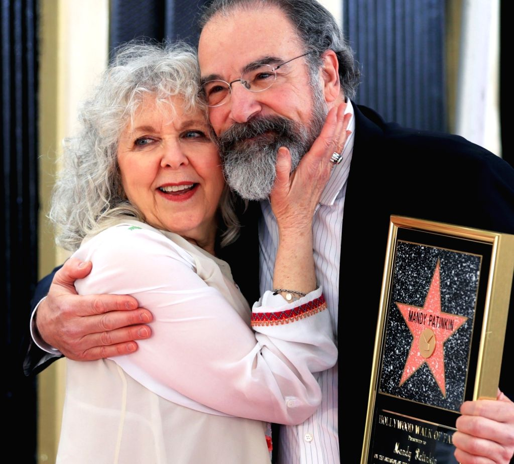 LOS ANGELES, Feb. 13, 2018 - Actor Mandy Patinkin (R) attends a star honoring ceremony with his wife on the Hollywood Walk of Fame in Los Angeles, the United States, Feb. 12, 2017. Mandy Patinkin was ... - Mandy Patinkin
