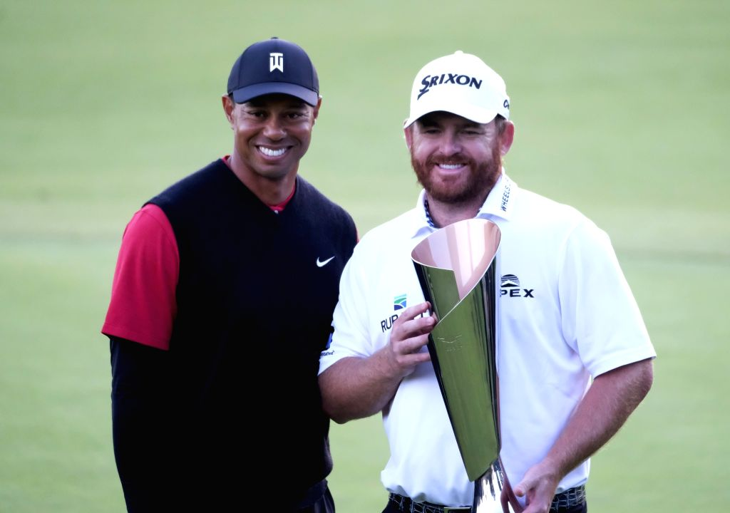 LOS ANGELES, Feb. 18, 2019 - J.B. Holmes (R) of the United States poses with Tiger Woods after winning the PGA Tour Genesis Open golf tournament in Los Angeles, the United States, Feb. 17, 2019.