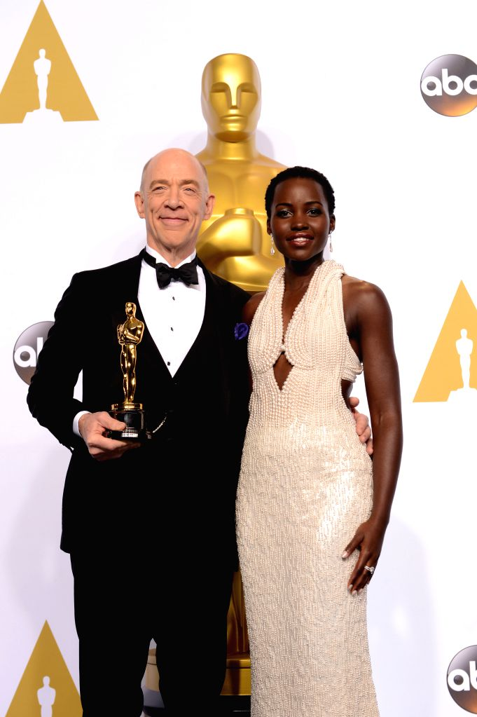 """Actor J.K. Simmons (L) poses with Lupita?Nyong'o after winning the Best Actor in a Supporting Role award for """"Whiplash"""" during the 87th Academy Awards ... - J."""