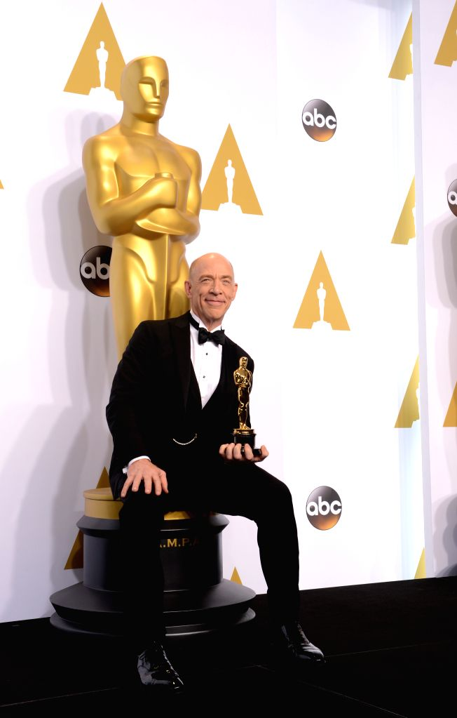 """Actor J.K. Simmons poses after winning the Best Actor in a Supporting Role award for """"Whiplash"""" during the 87th Academy Awards at the Dolby Theater in ... - J."""