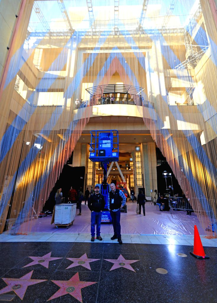 LOS ANGELES, Feb. 24, 2019 - Photo taken on Feb. 23, 2019 shows staff members at the Dolby Theatre in California, the United States, where the Academy Awards ceremony, or Oscars, will take place the ...