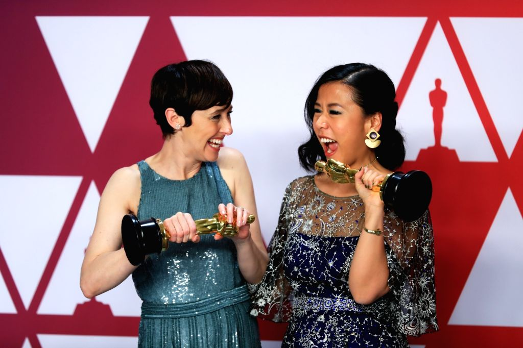 "LOS ANGELES, Feb. 25, 2019 - Becky Neiman-Cobb (L) and Domee Shi pose for photos after winning the Best Animated Short award for ""Bao"" in the press room during the 91st Academy Awards ..."
