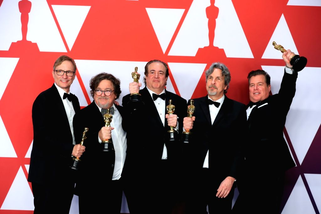 """LOS ANGELES, Feb. 25, 2019 - Cast members of the """"Green Book"""" pose for photos after winning the Best Picture award in the press room during the 91st Academy Awards ceremony, or the Oscars, ..."""