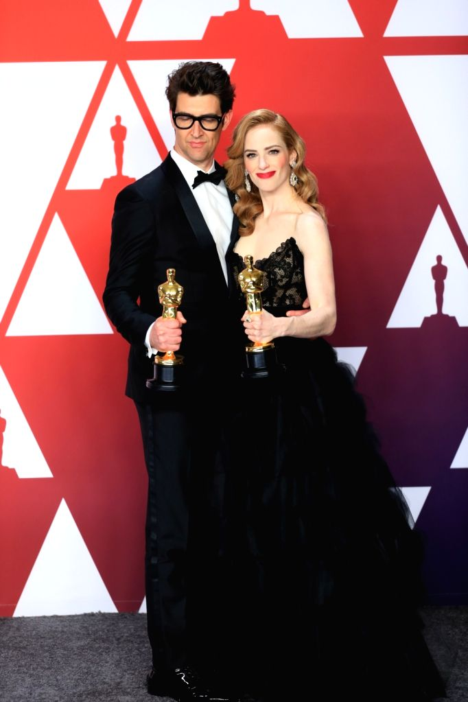 """LOS ANGELES, Feb. 25, 2019 - Guy Nattiv (L) and Jaime Ray Newman pose for photos after winning the Best Live Action Short Film award for """"Skin"""" in the press room during the 91st Academy ..."""