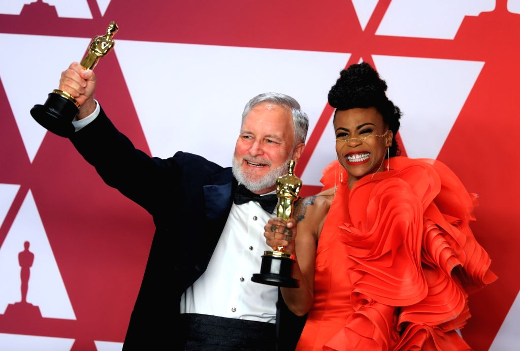 "LOS ANGELES, Feb. 25, 2019 - Hannah Beachler (R) and Jay Hart pose for photos after winning the Best Production Design award for ""Black Panther"" in the press room during the 91st Academy ..."